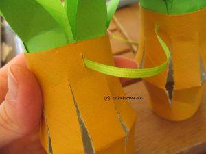 Ananas auffädeln
